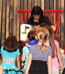Librarian reading to a group of children